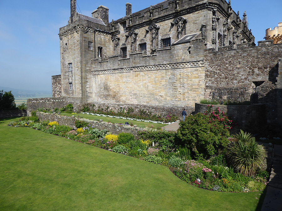 castle with green lawn in front of it