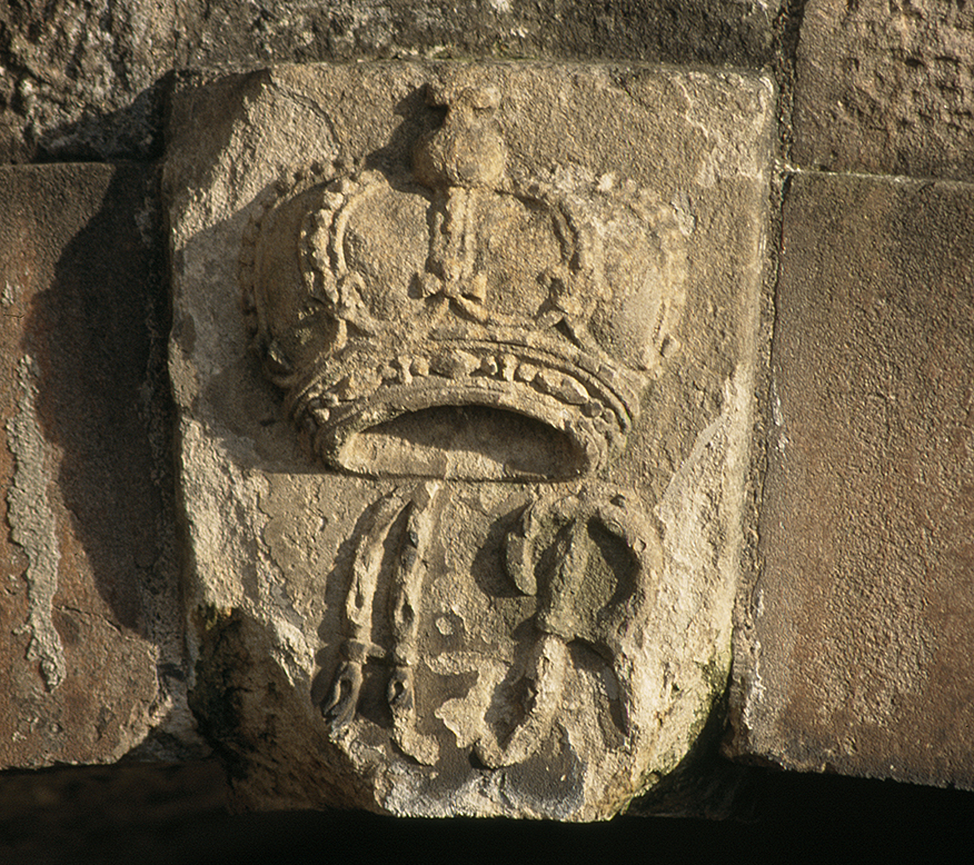 carved stone with crown and initials AR