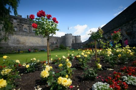 A view of Stirling Castle gardens with lawn and flower bed.