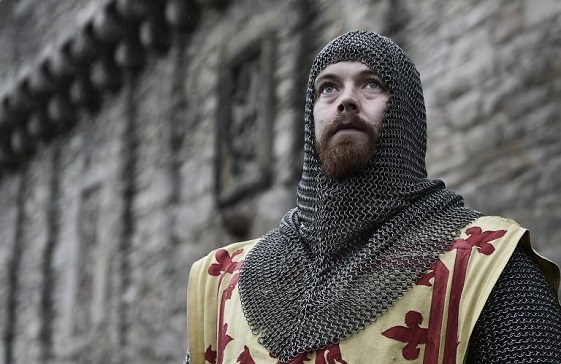 reenactor dressed as Robert the Bruce, wearing chain mail and Lion Rampant tabard