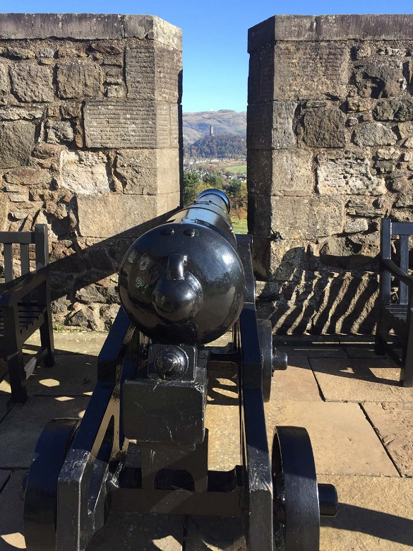 A cannon on the ramparts of a castle