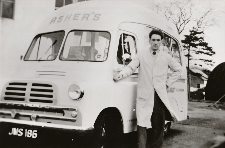 "Archive photo of an ince cream man posing outside his Bedford van. The name ""Asher's"" is written on the front of the van."