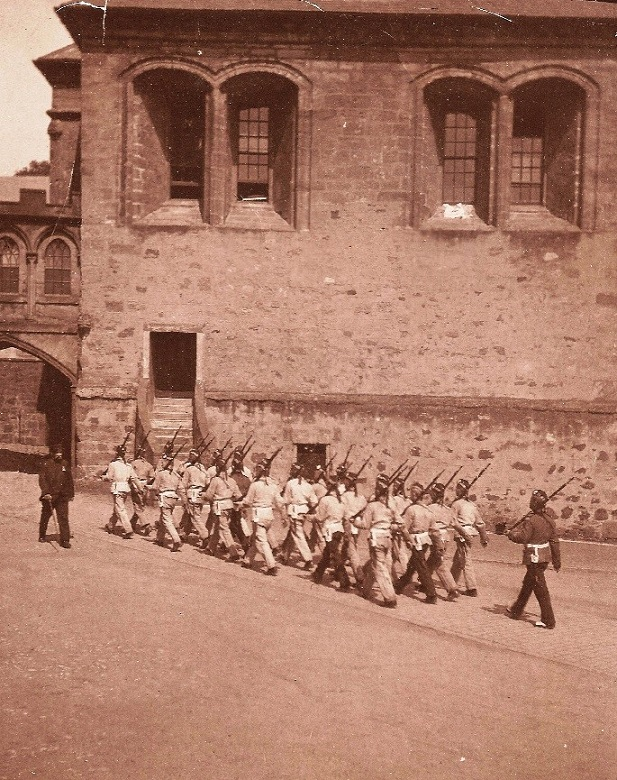 Archive photo of soldiers marching through a castle courtyard