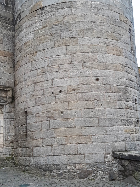 Holes in the gatehouse wall caused by artillery fire
