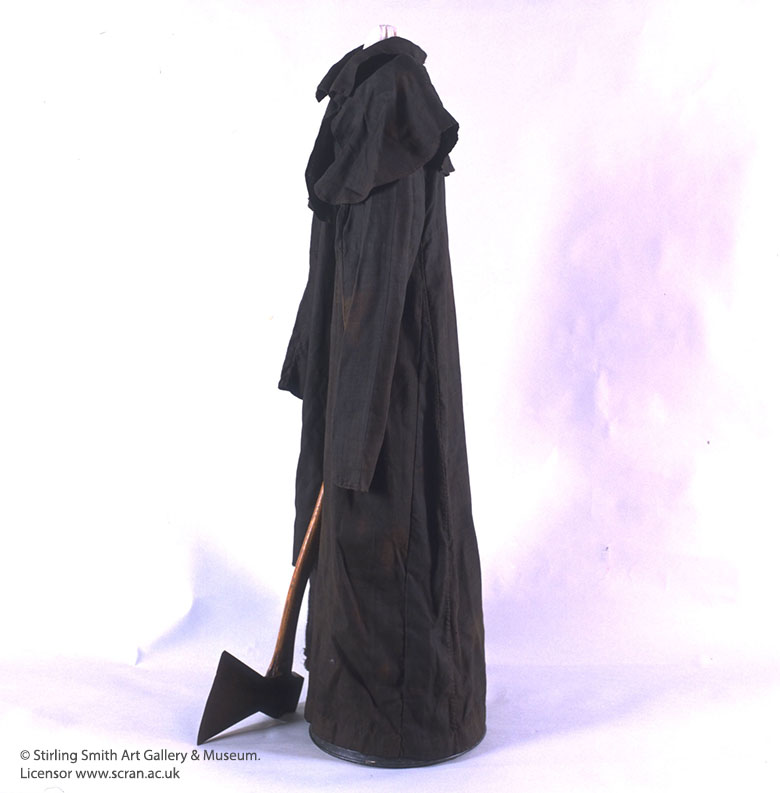 An image showing the black robe and axe of the executioner.