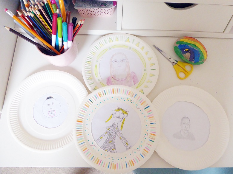 Childrens' drawings on a paper plate replicating the Stirling Castle heads