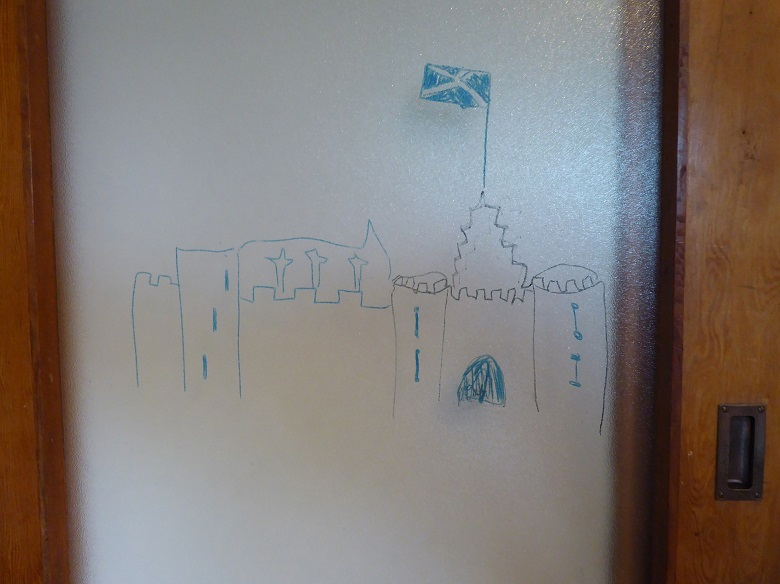 A child's drawing of Stirling Castle on a glass door