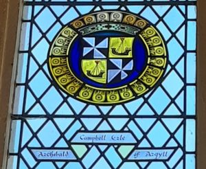 The coats of arms of Archibald Campbell depicted in stained glass