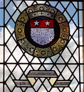 The coats of arms of John Douglas depicted in stained glass