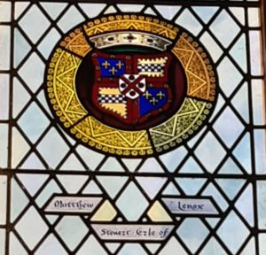 The coats of arms of Matthew Stewart depicted in stained glass