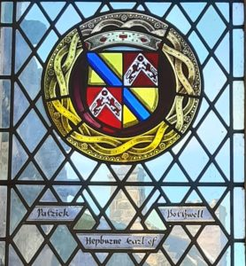 The coats of arms of Patrick Hepburn depicted in stained glass