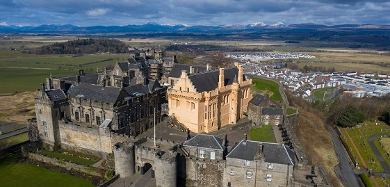 An aerial view of Stirling Castle with the distinctive golden great hall