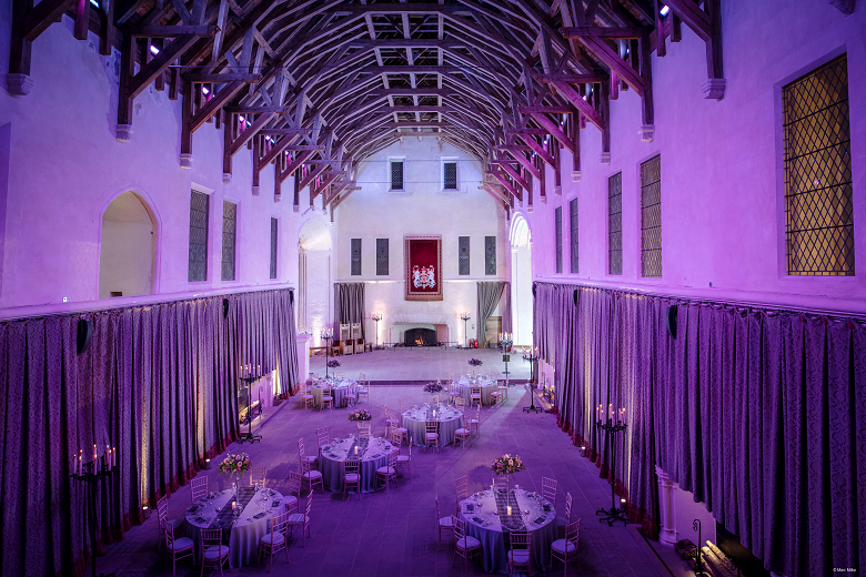 Tables laid out in the great hall at Stirling Cast;e ready for a wedding