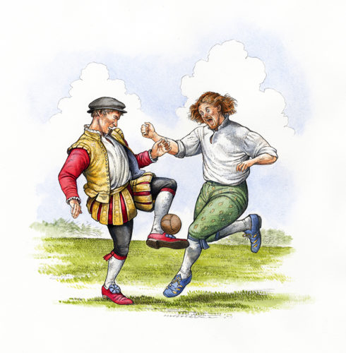 two people kicking a football