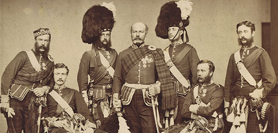 a group of 7 men in military dress form the 1860s