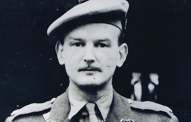 a man wearing military uniform. He has a small moustache.