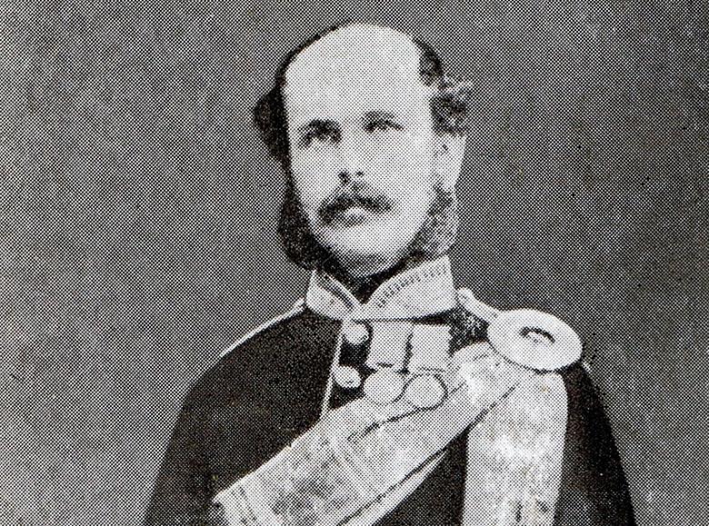 a Vicotiran era man wearing military uniform. He has a mustache and mutton chop facial hair